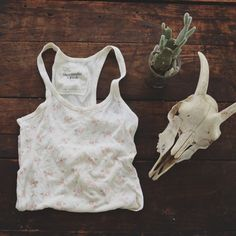 A&F/ floral racerback tank ⱝ light cream, pink rose floral pattern ⱝ camisole, tank top ⱝ soft, stretchy cotton ⱝ abercrombie ⱝ fits an xsmall or small ⱝ back seam coming undone, but can be fixed ⱝ used condition   » I NO LONGER LOWER MY PRICES, BUT OFFERS ARE ABSOLUTELY WELCOMED  » UNLESS ITS FOR A BUNDLE, I WILL NOT RESPOND TO OFFERS IN COMMENTS   » I WILL MAKE A NEW LISTING FOR DISCOUNTED SHIPPING Abercrombie & Fitch Tops Tank Tops
