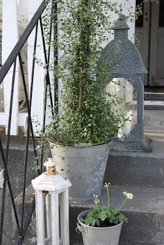 galvanized lanterns and buckets on the front step