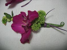 purple glad boutonniere by Shady Grove Gardens, via Flickr