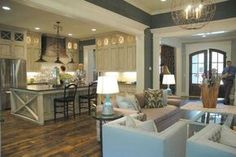 Traditional Great Room with Crown molding, French doors, Exposed beam, Hardwood floors, Chandelier, can lights