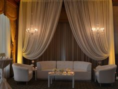 curtains for drama, warmth, ambience, intimacy. lounge area idea
