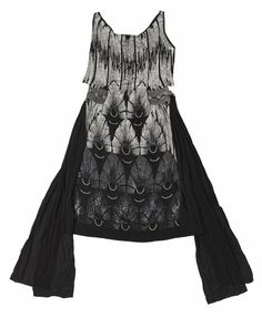 Woman's evening dress of black chiffon, decorated with glass beads, glass imitation diamonds and silver metal sequins: French, c. 1929  Museum reference A.1965.629