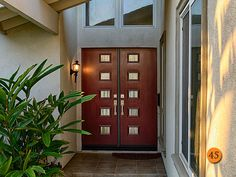 AFTER:  Contemporary Double Entry Doors. Thermatru Smooth fiberglass model S5RXJ-PULSE 5 LIGHTS Painted vineyard. Betek Baden entry handles. Installed in Anaheim, CA home.