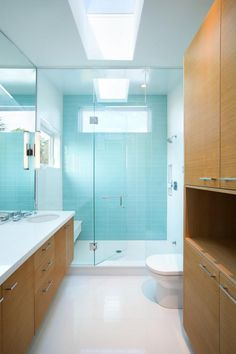 Blue Feature Wall In Contemporary Bathroom // Randy Bens Designs A House On A Corner Lot In Vancouver Downstairs Bathroom, Bathroom Layout, Modern Bathroom, Minimalist Bathroom, Blue Feature Wall, Blue Tiles, Rustic Contemporary, Home Decor Furniture, Modern Interior Design