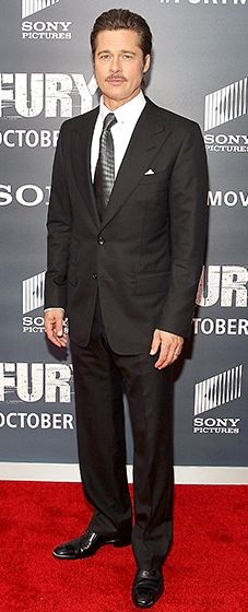 Menswear master! Mr. Pitt shows how it's done in a black suit with a steel grey tie.