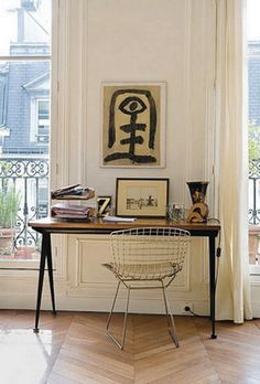 Everything looks great with french windows, especially in Paris. (Bertoia chair and that view!)