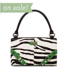 """Zoe (green) - It's black and white and fun all over—it's also right on trend with spring 2011's fashion runway looks. The Zoe Shell for Classic Bags is Miche's homage to the """"wild side"""" in every woman! Chic zebra faux leather pattern is whimsically punctuated with brightly-colored studded """"buckle"""" corner accents in hot shades of yellow, pink, green and aqua."""