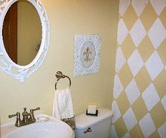 Painting a diamond pattern on one wall in a bath adds a big focal point! I've also done this in a master bedroom. I recommend sizing your diamonds according to the size of your wall!