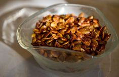 My lazy version of these awesome sweet-spicy pumpkin seeds: Preheat oven to 350. Mix 1 tsp chili powder, 1 tsp chipotle powder, 1/2 tsp salt, 2 packets splenda in a large bowl. Add 2C pepitas (pumpkin seeds), 4 large/6 medium cloves pressed garlic, juice from 1 lime and mix. Spread on pre-greased cookie sheet and bake for 15 min. 143 cal per 1/2 C serving.