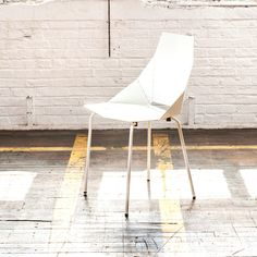 I'm thinking about doing these chairs for the dining area. Seating for 8.  Real Good Chair in white, by Blu Dot / $120