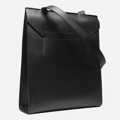 Italian leather. Envelope-inspired design. An elevated take on the leather tote. It's handmade in Italy from 100% full-grain Italian leather. The tote features ultrasuede lining, interior zip pocket, internal hook & bar closure, and contrasting patent leather under the envelope flap