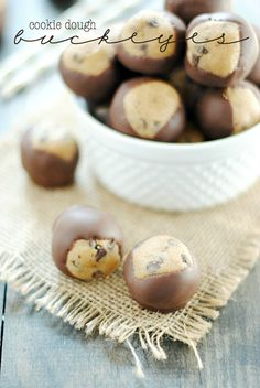 Cookie Dough Buckeyes- Eggless cookie dough gets dunked in delicious milk chocolate for an irrestible, no bake dessert.