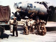 "An Air Force navigator on B-17 ""Sweet and Lovely"" tosses flight bag on truck after mission. Lt. makes reports. 8th Air Force, England"