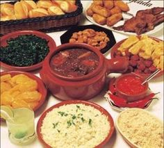 I currently reside in Brazil and this is what people eat everyday....feijoada completa! rice, beans, meat, farofa...delicious! muito bom