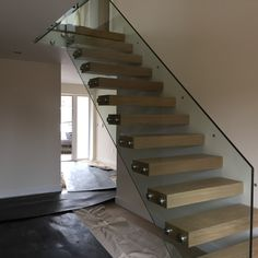 Floating staircase with frameless glass balustrade, supplied and fitted by Morris Fabrications Ltd. Floating Staircase, Modern Staircase, Stair Railing, Stairs, Frameless Glass Balustrade, Country Style, Sweet Home, Staircases, Architecture