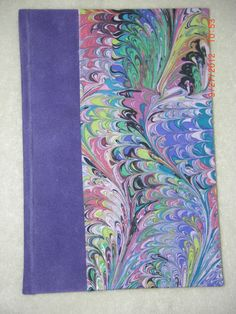 Blank journal with Purple imitation suede on spine and cloth marbled cover. Made by Roxanne