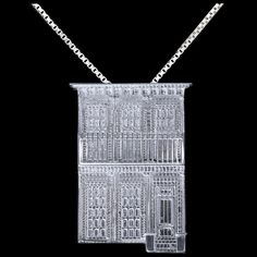 This piece is solid silver and was worked on for hundreds of hours to capture every detail of a New Orleans gallery home. Only 500 ever made.