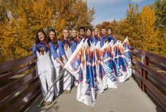 Boise State color guard members take time out of their busy fall season for a shot on the newly refurbished Friendship Bridge that connects campus to Julia Davis Park and the City of Boise. Part of the Keith Stein Blue Thunder marching band, the color guard visually accents the band through movement and dance using props such as brightly colored flags, rifles, hoops and more. The group is coached by Melonie Reno.    Chandelle Arner photo