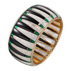 Étourdissant Cartier bracelet in 18k yellow gold, emeralds, rock crystal, onyx, and diamonds