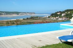 Casa do Lago family villa is located on the Silver Coast of Portugal. Stunning views from the swimming pool. Sleeps 12.