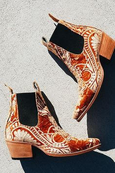 Cute red and cream print boots.