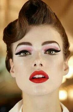 Retro pin up pink shadow cat eye red lips flawless skin