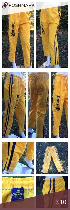 """🍺Corona Beer Windbreaker Pants Women M Men S🍻 Corona Extra 🍻 brand yellow windbreaker pants w pockets & drawstring elastic waist.  Tag is marked M - they fit women medium & men small Two small slits at the bottom of each leg opening.  Measurements laid flat-  Waist: 12""""/24"""" doubled w lots of stretch Hips: 20""""/ 40"""" doubled Overall length: 38"""" Inseam: 25"""" Rise: 14.5"""" Thanks ! 🍺🍻🍻 Corona Extra Pants Track Pants & Joggers"""