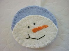 Hey, I found this really awesome Etsy listing at http://www.etsy.com/listing/86220186/felt-snowman-ornament-applique-wool