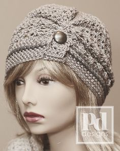 Ravelry: Ruched Lace Beanie with Button Tab pattern by Pamela Dempsey