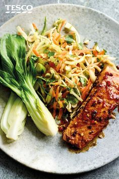 Asian salmon fillets Ramp up the flavour of salmon fillets with this sticky-sweet Asian-style soy sauce, ginger and chilli marinade. Pair with a nutty slaw and pak choi for a midweek meal that's ready in minutes. Salmon Recipes, Fish Recipes, Seafood Recipes, Gourmet Recipes, Asian Recipes, Dinner Recipes, Cooking Recipes, Healthy Recipes, Cake Recipes