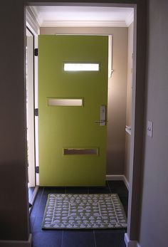 Crestview doors...texas company that makes new door for old houses & The green door and potted plants make this mid-century modern ...