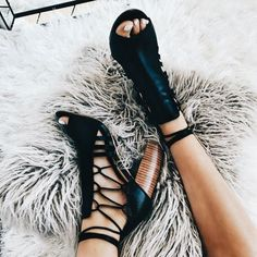 Cute black laced heels.