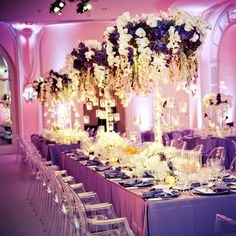 Wedding Reception- Beverly Hills Hotel, white carpet, tall centerpieces, purple hydrangeas, orchids and roses, hanging candles www.aboutdetailsdetails.com