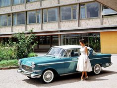 1958 Opel Kapitän The lady looks like my sister's early Barbie doll from 1959. And just look at the charming way she sets her feet - let's hope she does not stumble when walking away.   This Kapitän, the P2.5, was only produced in 1958 and 1959. Apparently, styling was considered a bit too 'American' for European taste, so a toned down version, the P2.6, was introduced in 1959.  Opel publicity photo found on the internet.