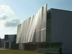 Wind Wall is a 32' high and 85' long wall of wind-activated pendulums covering the entire front façade of LIGO's Science Education Center. Each pendulum is magnetically coupled with its neighbor so that the whole wall reveals beautiful fluid-like motions as energy is transferred from one pendulum to the next.
