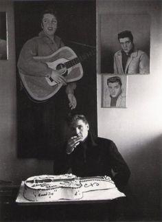 "Elvis Presley having a piece of ""King Of Rock & Roll"" cake."