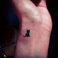 My kitty cat tattoo I think behind the ear in honor of my late baby black