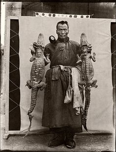 Alligator Hunter, China. About 1910. Photograph via Wolfgang Wiggers on Flickr