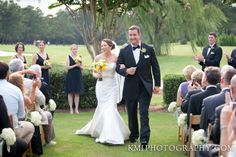 Outdoor Wedding Ceremony at Porters Neck Country Club in Wilmington, North Carolina. Photography by KMI Photography