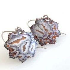 "These are a pair of enameled 7/8"" lotus shaped earrings."