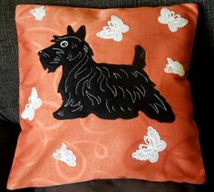 This pillow cover features a black Scottish terrier surrounded with white butterflies.  The design is original and you will not find any other cover like this. This colorful and unique pillow is guaranteed to bring individuality to a home and will make a wonderful present for any other occasion for your family, friends and yourself.  It is completely hand-sewn, I used the applique technique, crochet and embroidery when making it. The appliqued details are made of soft quality fleece, the fur…