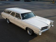 """I don't remember the year but we bought a 1966 Pontiac Bonneville Station Wagon as the first of several station wagons.  Ours was painted yellow and it must have been when the Beetles were popular because we would drive down the road with the kids singing """"we all live in a yellow submarine"""".....hahaha"""