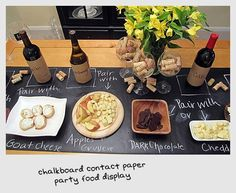 This chalkboard contact paper makes for a great party food display... A large roll of brown craft paper would also do the trick!