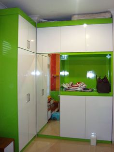 Green and white cabinet at Wisata Bukit Mas Surabaya by Simple Luxury Interior, Indonesia