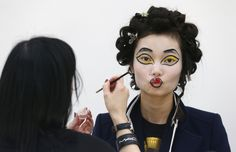 A model has her makeup applied before the Vivienne Westwood Red Label Autumn/Winter 2013 collection presentation (Picture: Reuters)
