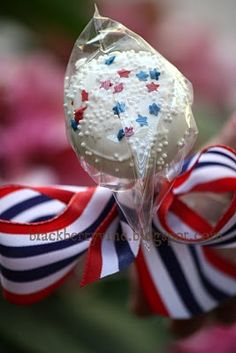 Inspiration.    Idea: dip oreos in white chocolate melts, add patriotic spinkles, stick, and ribbon.