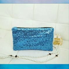Glitter sequin clutch Blue glitter sequin clutch. Leopard print lining . Measurements 26?16 cm.  Accidentally tore a small hole in the protective plastic. Bags Clutches & Wristlets