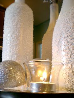 Painted bottles covered in Epson salt for a Winter Wonderland effect by Cleverlyinspired.