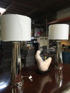 GREAT PAIR OF HOLLYWOOD REGENCY OVERSIZED SILVERED GLASS TABLE LAMPS MEASURING 41 INCHES IN HEIGHT WITH A 9 INCH ROUND BASE THAT TAPERS TOWARDS THE SHADE. BOTH IN GOOD CONDITION WITH GENTLE SIGNS OF WEAR.