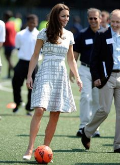 Not even coordinated enough to play football, let alone in heels. Is there anything Kate can't do?